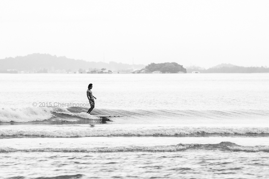 Mike Lim form Singapore catching his early monsoon season wave at Cheratingpoint