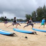 Warming up with the student is a must here at cheratingpoint surf school.