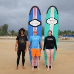 Trosten and Bianca from Germany living in China trying their first time surfing